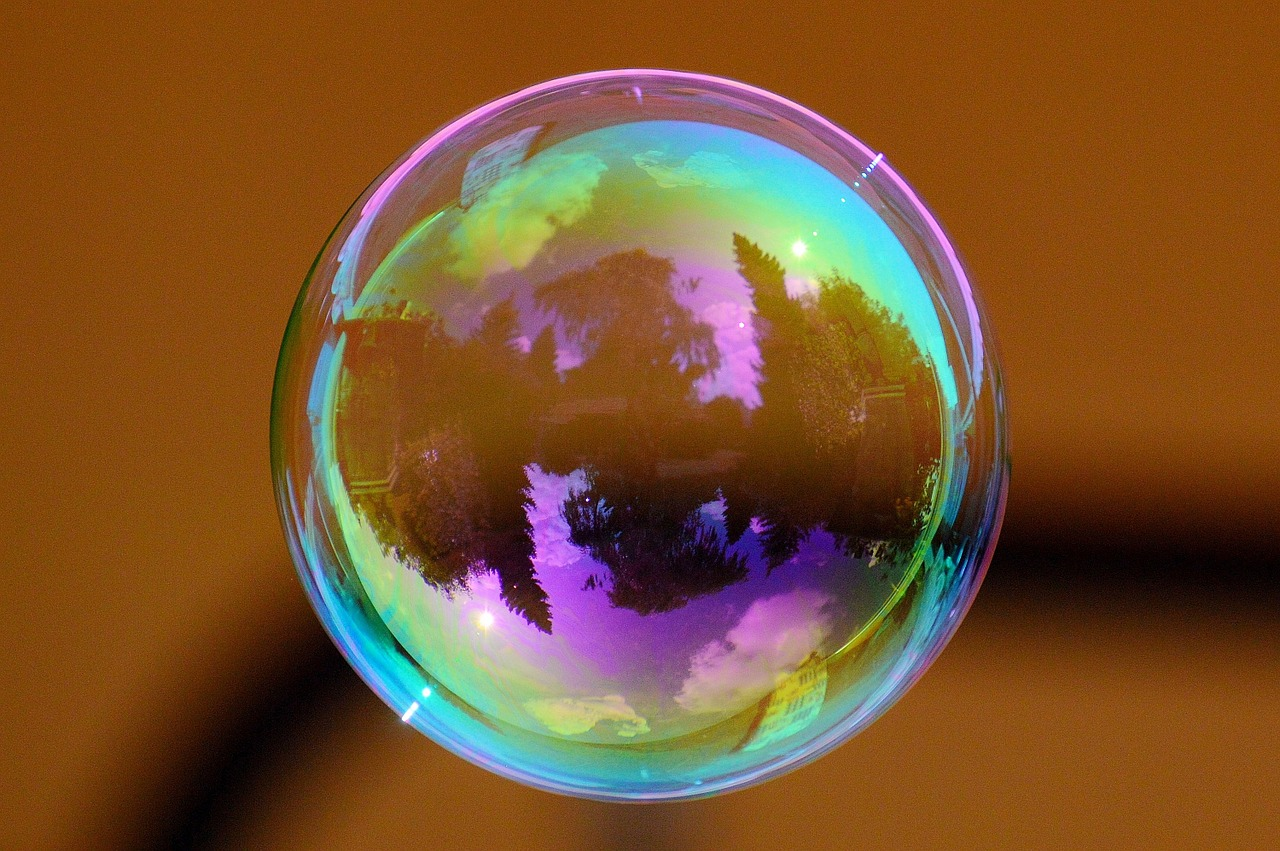 Visualization Techniques iridescent bubble with a tree lined lake in its reflection