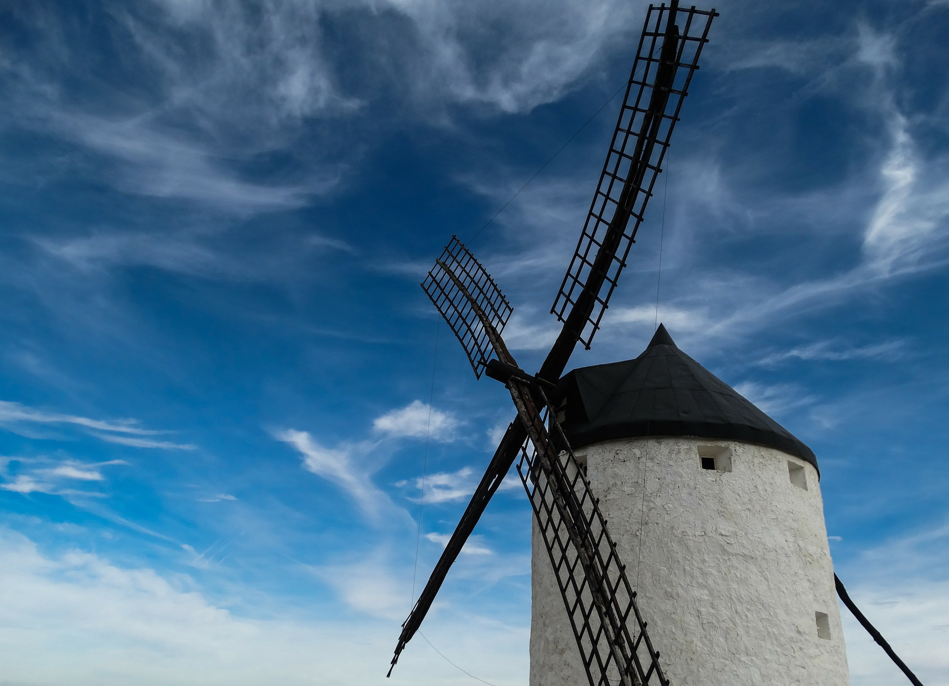 Nature sounds for sleep -a black and white windmill set against a blue sky with wispy clouds